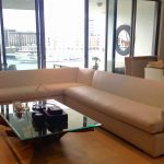 White vinyl L-shaped couch