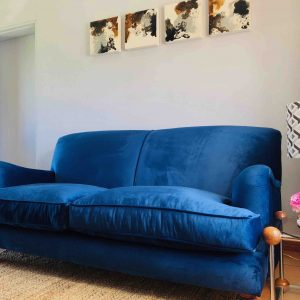Blue velvet two seater couch