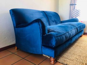 Blue velvet couch side view