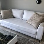 couch upholstered with white leather
