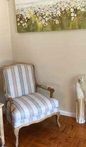 antique chair with striped fabric